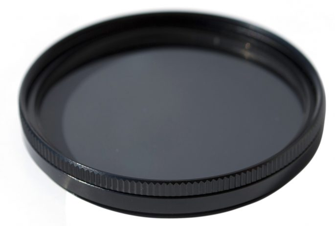 A polarizing filter has dual uses